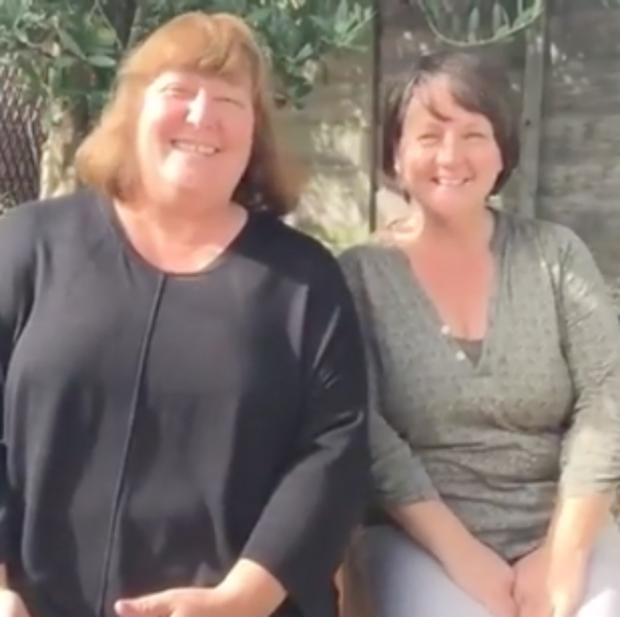 Nicola and Sarah in the garden talking about emptying cupboards, Nicola's ginger hair and autopsies