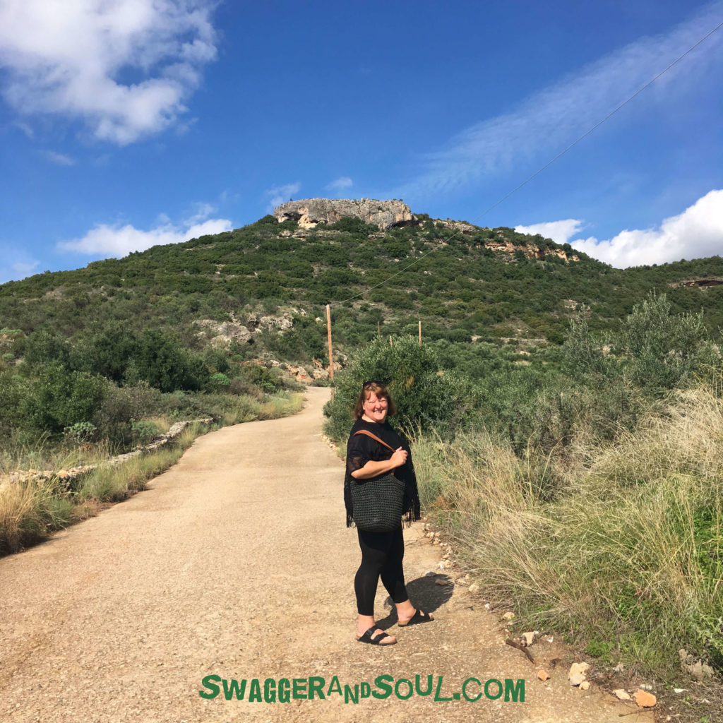 Nicola walking up a hill in Stoupa - Doing nothing versus digital nomad productivity