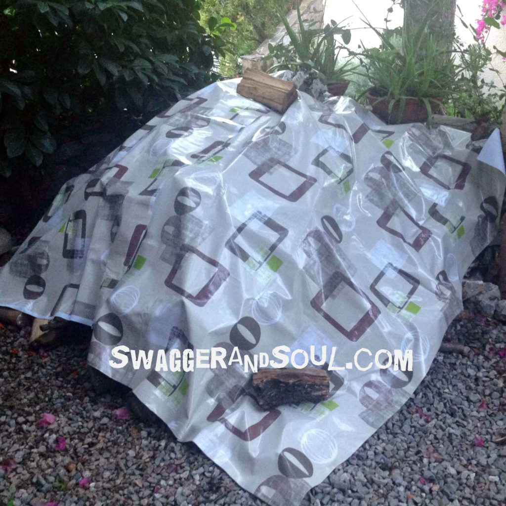 Retro design tablecloth covering a woodpile and kindling