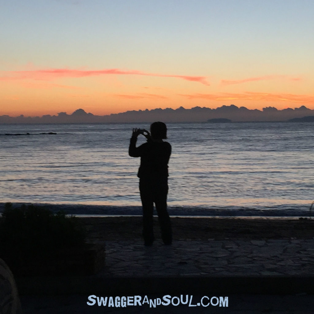 Nicola has taken a photo of Sarah taking a photo of the sunset in Stoupa. It's a little fresh here!